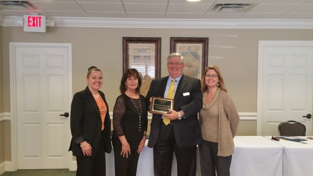 Left to Right: Danielle Cooley, VP; Jeane Bargo, MC;  Ed Clements, host; Teresa Parker, President.
